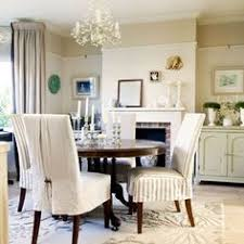 french inspired dining room fabric covered chairs and painted furniture give this dining room a distinctive french feel a chandelier adds an air of