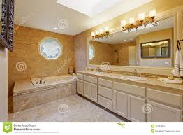 Luxury Bathroom Interior With Tile Trim And Big Vanity Cabinet - Trim around bathroom mirror