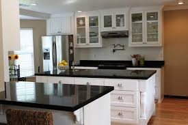 kitchen black countertops white cabinets