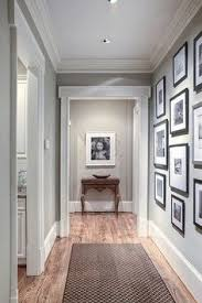 craftsmen style door frames go great with modern picture frame collages the clean lines pliment