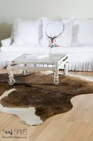 living room ideas with cowhide rug. awesome cowhide rug with coffee table and sofa also wood flooring for living room design ideas