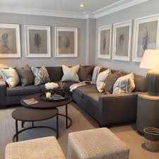 grey walls with brown furniture. paint colour with large white frames sophie paterson interiors uk art work grey walls brown furniture