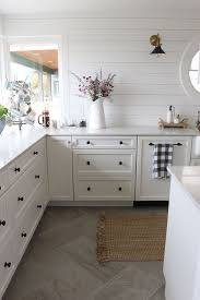 Kitchen floor tiles White Really Warm Inviting White Kitchen With Unique Black Cabinet Hardware Wood Plank On Walls And Love That Tile On The Floor Bob Vila Small Kitchen Remodel Reveal Universe Kitchen Remodel Kitchen