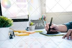 Graphic Designer At Desk Graphic Designer Using Graphics Tablet To Do Work At Desk