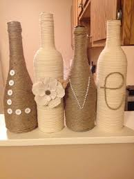 vintage diy wine bottle decorating ideas with yarn application and large  letter decoration shaping love in