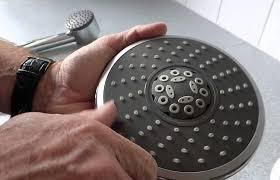 how to clean a clogged shower head cleaning with vinegar is the best way