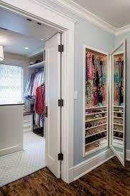 built in jewelry storage with a mirror door