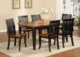 black and brown painted oak mission style dining room set with rectangle wooden dining table and 6 dining chairs with white carpet tiles and hardwood floor