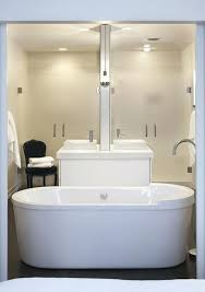 two sided bathtub master bathroom with back to back rectangular vessel sinks separated by a two two sided bathtub