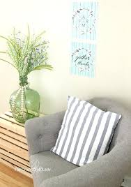 best way to hang pictures without damaging the wall a simple tip for hanging posters without best way to hang pictures without damaging