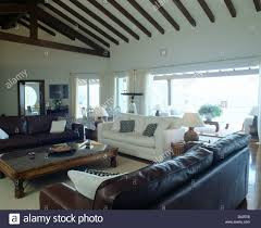 Of Living Rooms With Leather Furniture Brown Leather Sofas And White Sofa In Modern Coastal Living Room