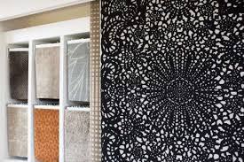doily rug by delinear right is seen hung along with other delinear rug samples