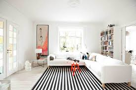 living room modern orange accents black and white striped rug white sectional sofa black white home office cococozy 5
