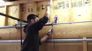 how to adjust garage door springsHow To tighten the garage door spring  YouTube