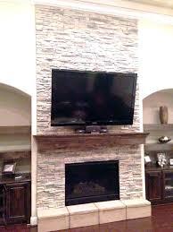 installing stone veneer over brick fireplace fireplace