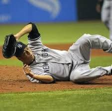 Hiroki Kuroda of the Yankees takes a charge. Oh wait! Wrong sport. Stay  upriht, Hiroki. | Yankees, Yankees pitchers, Major league baseball
