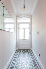 hallway, victorian tiles, victorian hallway tiles, antique mirror, pendant  lights, wallpaper