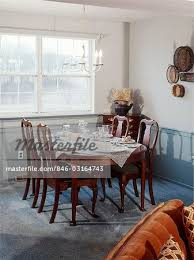 1970s dining room interior queen anne style table and chairs stock photo