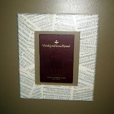 hymnal picture frame made using pages and cover from an old hymnal on an unfinished wood frame