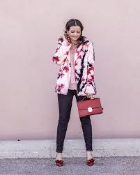 which is why i m loving this fl faux fur coat from guess the stunning pale pink is complemented with fuchsia and red fls making the coat more