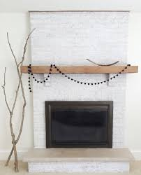 inspiring white brick fireplace for a brighter room design white brick fireplace with decorations and