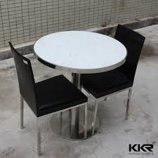 white quartz top round restaurant table and chair