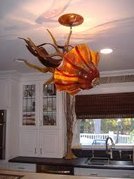 blown glass chandelier jellyfish light installation transitional kitchen
