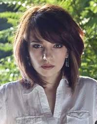 short cute hairstyle with layered bangs for thick hair