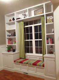 built in bookshelves around the window with a seat for daydreaming
