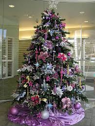 ... as you decorate your Christmas tree this year. Instead of going for  traditional colors such as red, gold and green, how about going for purple  and pink?