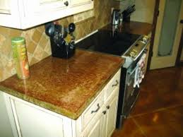 custom concrete countertops of oklahoma used a custom integral color to match the countertop to the cabinets backsplash and stained concrete floor