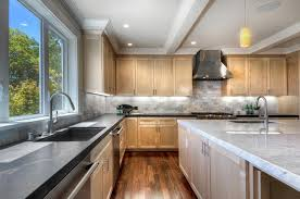 kitchen with soapstone counters and island with marble counter