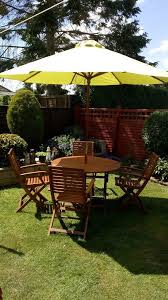 garden furniture 4 wood chairs large wood round table parasol base