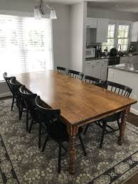 leg dining table with a jointed smooth top in vine early american stain in a satin finish paired with rustic windsor dining chairs painted black