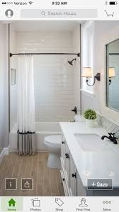 I love the tiled shower and the color. Love the can lights, lamp, and  mirror. The contrast of the white with the dark handles. I love the wood  tiling for ...