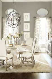 beautiful orb chandelier for interior lighting ideas orb chandelier with metal and round dining table