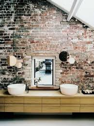 Exposed Brick Wall Ideas  Sleek bathroom appliances look great with rugged  brick in this awesome attic bathroom.