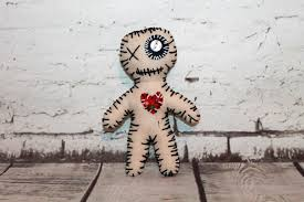 voodoo doll with pins voodoo
