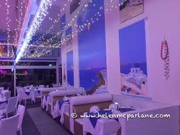 george s paragon seafood restaurant sanctuary cove inside of restaurant with greek island wall mural