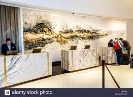 miami beach florida loews miami beach hotel front desk reservations check in artwork wall installation sculpture sarah raskey man agent job lobby