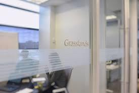 3d office door sign letters on glass near sliding meeting room door that read grasslands
