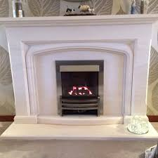 limestone fireplace with gas fire
