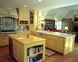 Example of a mountain style kitchen design in Los Angeles with yellow  cabinets, beaded inset