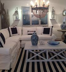beaded coastal chandelier in beach house slipcover living room