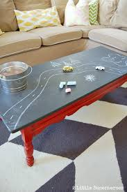 another chalkboard coffee table with a red base