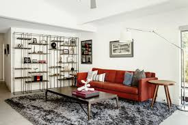 a large rug anchors the den tv room of a remodeled midcentury modern home in sacramento ca photo by carlos chavarria curbed handbook