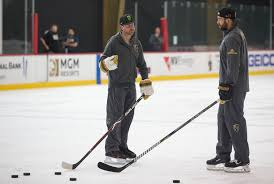 nascar driver kurt busch left takes hockey pointers from vegas golden knights defenseman deryk