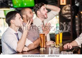 watching football stock images royalty images vectors men fans watching football on tv and drink beer three other men drinking beer and