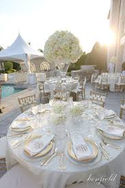 Like the monogram napkins Wedding Reception Tables & Venue. Tall white  hydrangea centerpiece on all white tables with gold chivaris and gold  beaded chargers ...