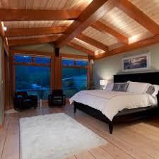 lighting for beamed ceilings. Rustic Light Green Bedroom With Exposed Beam Ceiling Lighting For Beamed Ceilings